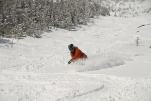 A man enjoying powder conditions in the Slides
