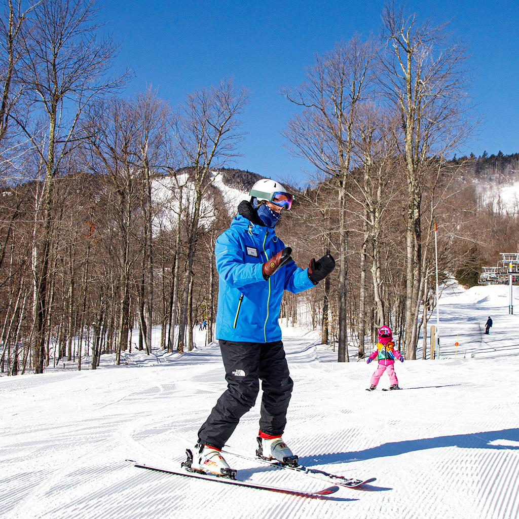 Small child in snowsports lesson on skis at Bear Den Learning Center.