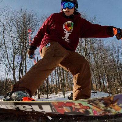 Skier riding a rail in Broadway Park at Whiteface.