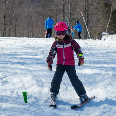 Happy child on skis.