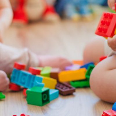 Children at cub camp play with building blocks