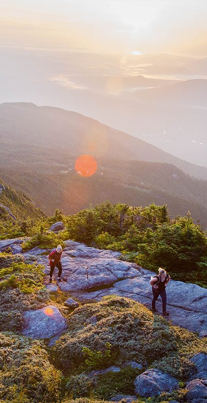 Two hikers on Whiteface at sunrise.