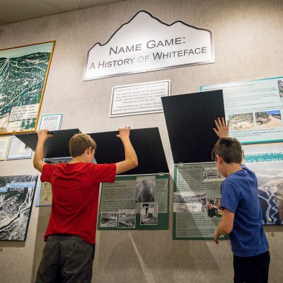 Two boys looking at Lake Placid Olympic Museum exhibit.